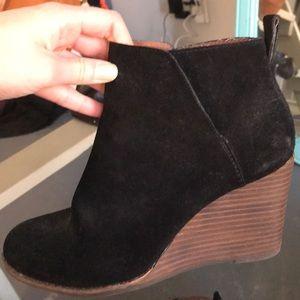 Black wedge booties